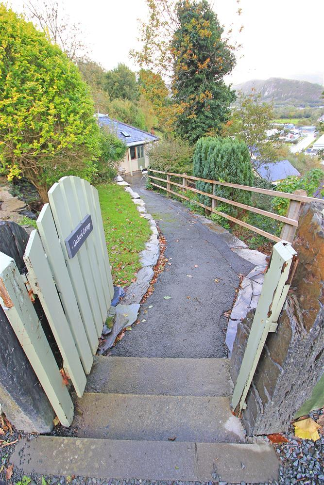 Access to the cottage is down 3 steps and this 15m tarmacadam sloping footpath to reach the patio area