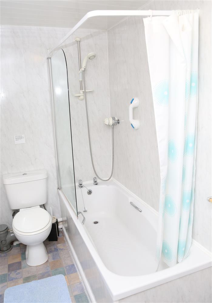 Bathroom with shower over bath & WC