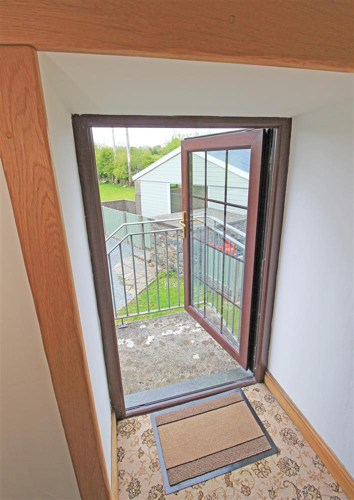 The small extrnal door to the top of the extrnal staircase. from here you can see the barn with the swimming pool.