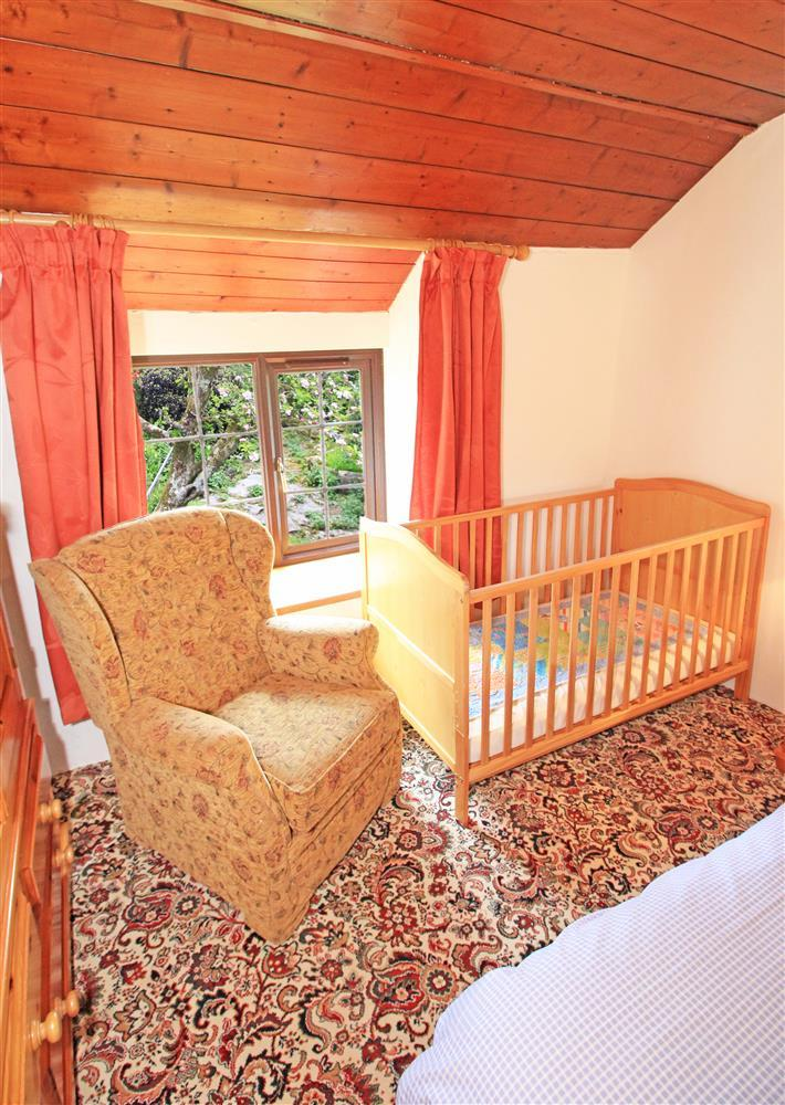 Bedroom 1 has a cot (1st Floor in the farmhouse)