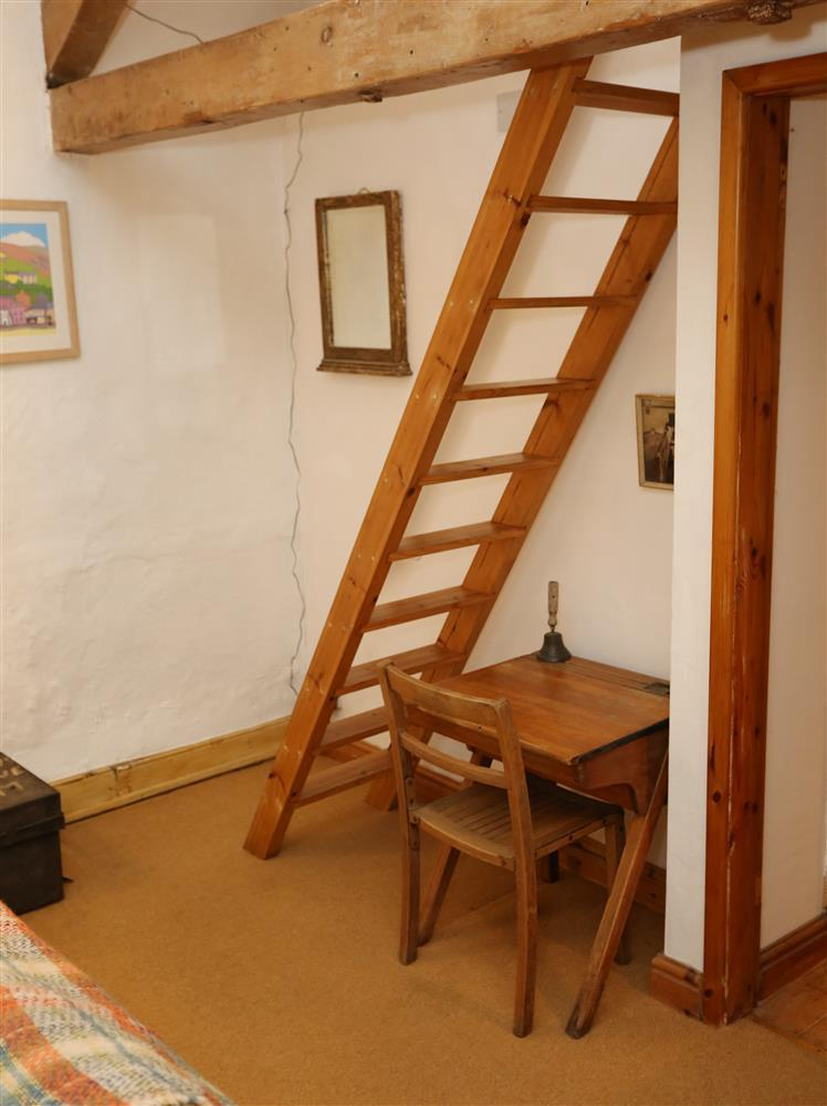 The ladder to the crog loft (Bedroom 3) and a reminder of School Cottage's past! Open stairs which are slightly narrower and steeper than usual and open roof trusses to lounge space. Not suitable for young children or the infirm.
