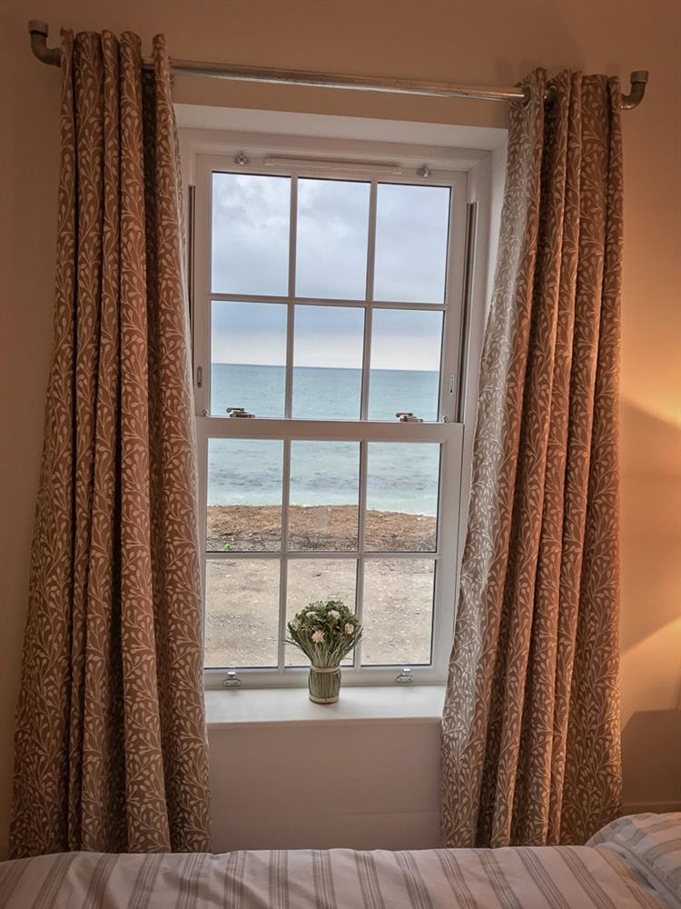 The view from the Double bedroom of the sea and the beach