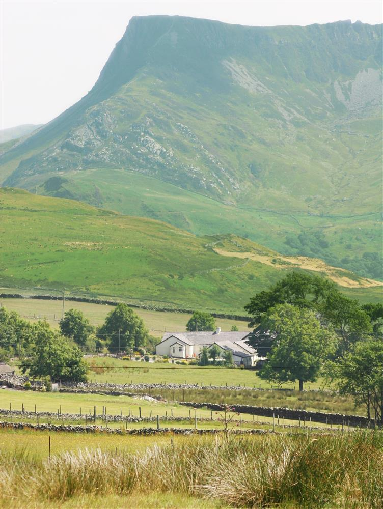 The view of the house, nestled in the Snowdonia mountains
