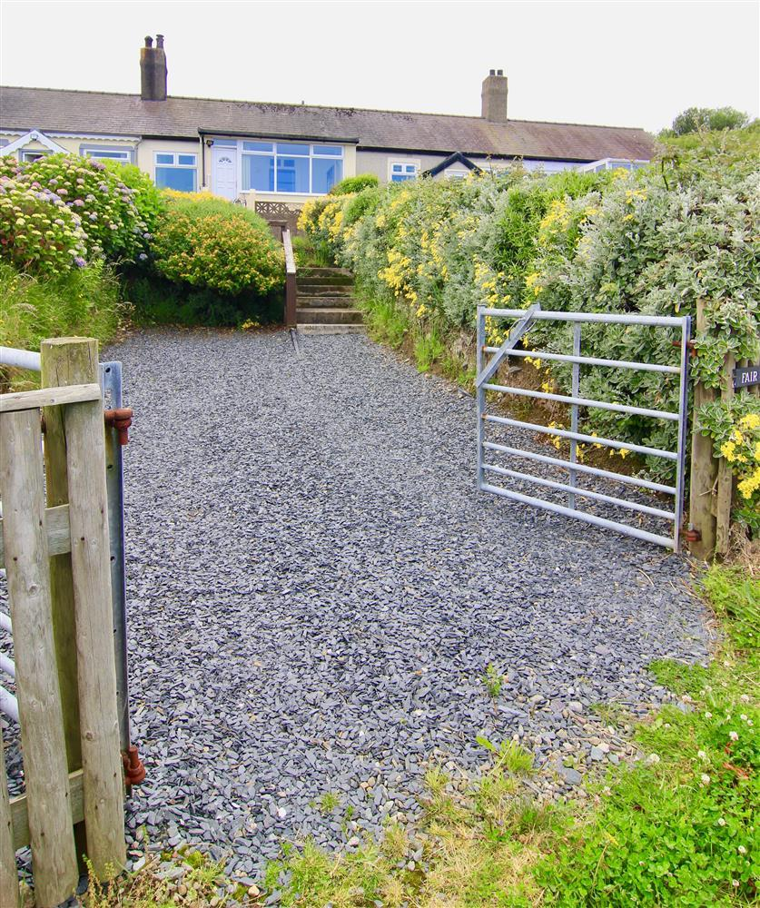 Entrance to cottage, large private parking area and secure gates.