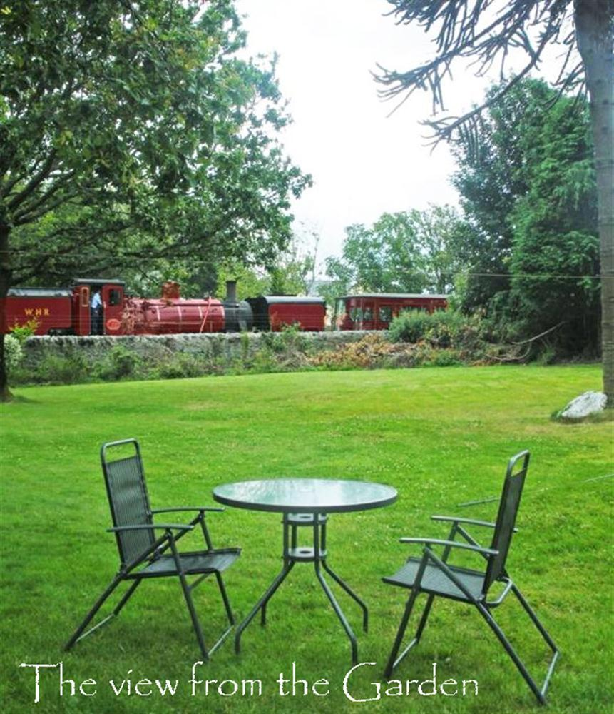 The Ffestiniog Railway runs past the bottom of the garden